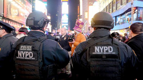 PHOTO: In this Dec. 31, 2015, file photo, NYPD Emergency Service Unit officers watch over revelers in Times Square on New Years Eve in New York. (Van Tine Dennis/Sipa USA via AP, FILE)
