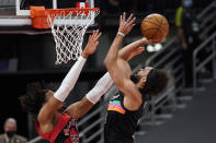 San Antonio Spurs guard Derrick White (4) puts up a shot over Toronto Raptors forward Freddie Gillespie (55) during the first half of an NBA basketball game Wednesday, April 14, 2021, in Tampa, Fla. (AP Photo/Chris O'Meara)