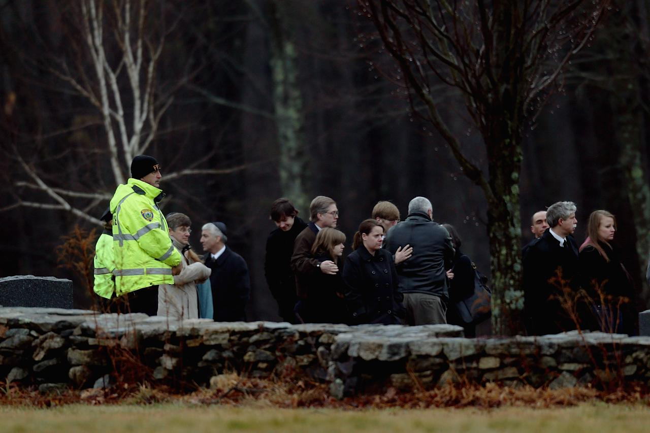 MONROE, CT - DECEMBER 17:  People attend the funeral services for six year-old Noah Pozner, who was  killed in the shooting massacre in Newtown, CT, at B'nai Israel Cemetery on December 17, 2012 in Monroe, Connecticut. Today is the first day of funerals for some of the twenty children and seven adults who were killed by 20-year-old Adam Lanza on December 14, 2012.  (Photo by Spencer Platt/Getty Images)