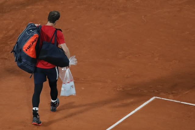 Andy Murray leaves the court after losing 1-6, 3-6, 2-6 to Stan Wawrinka in the first round at the French Open