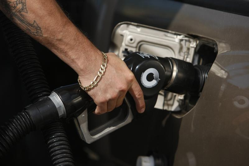 A man fills his truck up with gas at a gas station in Santa Monica