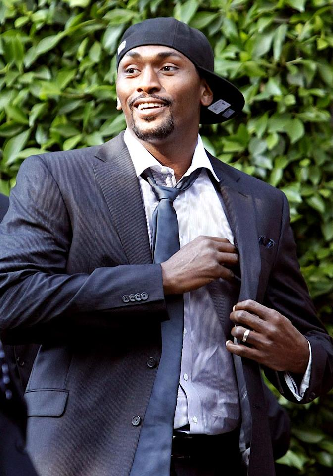 "Considering his $33 million deal with the Lakers, you'd think Ron Artest could afford to dress a little spiffier -- or at least surround himself with an entourage smart enough to tell him to ditch the fitted cap. Jean Baptiste Lacroix/<a href=""http://www.wireimage.com"" target=""new"">WireImage.com</a> - September 27, 2009"