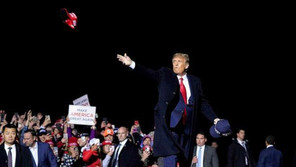 PHOTO: President Donald Trump throws hats to supporters after speaking at a campaign rally at Duluth International Airport in Duluth, Minn, Sept. 30, 2020. (Alex Brandon/AP, FILE)