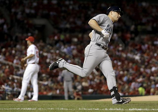 Seattle Mariners catcher Mike Zunino, right, rounds the bases after hitting a solo home run off St. Louis Cardinals starting pitcher Adam Wainwright during the fifth inning of a baseball game Friday, Sept. 13, 2013, in St. Louis. (AP Photo/Jeff Roberson)