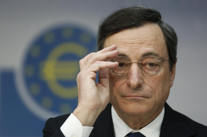 The President of the European Central Bank, ECB, Mario Draghi, speaks during a press conference in Frankfurt, central Germany, Thursday Dec. 6, 2012. The European Central Bank left rates unchanged at its meeting Thursday, and Mario Draghi gave little sign the bank was willing to add more stimulus. He said the bank had already done much to lower borrowing costs in heavily indebted countries that are struggling to grow. (AP Photo/dapd/ Alex Domanski)