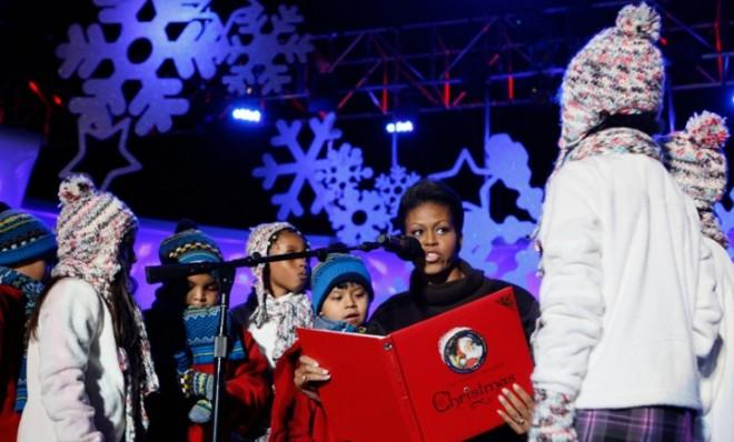 First Lady Michelle Obama reads a story to children at the National Christmas Tree Lighting Ceremony in 2009.