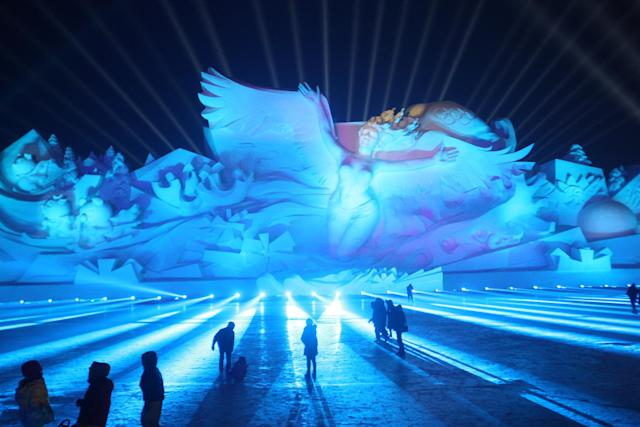 <p>Visitors attend a 3D light show at the Harbin Sun Island International Snow Sculpture Art Expo on Jan. 1. (Photo: Stringer/Reuters) </p>