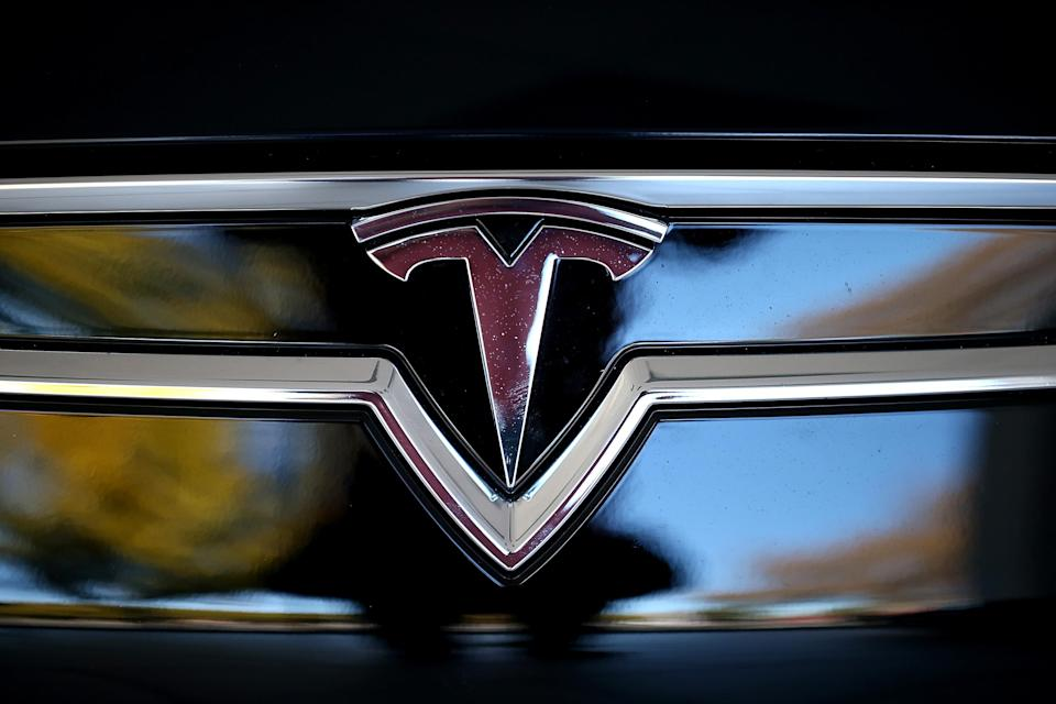 The Tesla logo is shown on the front of a new Tesla Model S car at a Tesla showroom on November 5, 2013 in Palo Alto, California. Tesla will report third quarter earnings today after the closing bell. (Photo by Justin Sullivan/Getty Images)