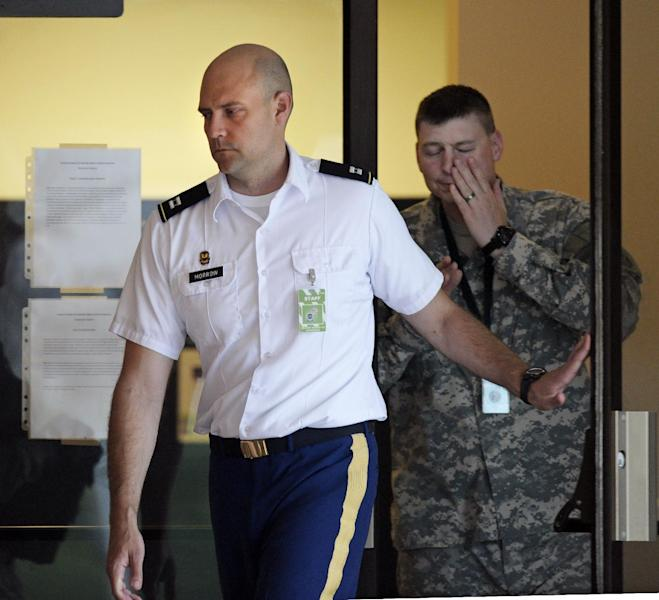 Army Capt. Joe Morrow, a member of the Army's prosecution team, exits the courthouse at Fort Meade, Md., on the fourth day of the court martial of Army Pfc. Bradley Manning, Monday, June 10, 2013. Manning is charged with indirectly aiding the enemy by sending troves of classified material to WikiLeaks. He faces up to life in prison. (AP Photo/Cliff Owen)