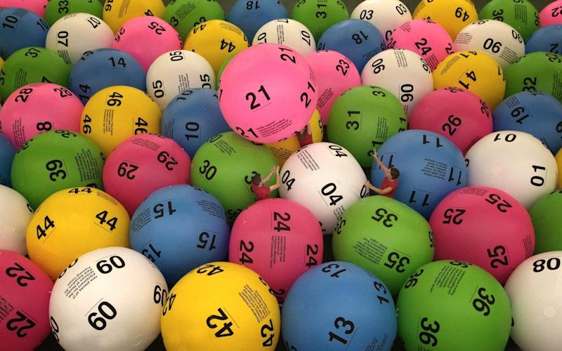 Anyone aged 16 or over can play the National Lottery - PA