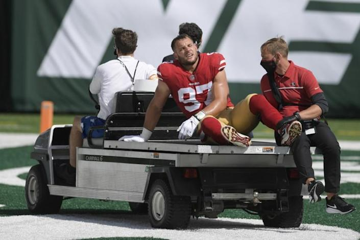 San Francisco 49ers defensive end Nick Bosa (97) is carted off the field after being injured during the first half of an NFL football game against the New York Jets Sunday, Sept. 20, 2020, in East Rutherford, N.J. (AP Photo/Bill Kostroun)