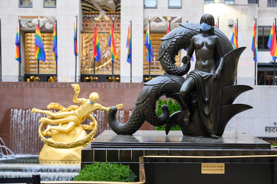 Prometheus (L) and the Maiden 'Mankind Figures' statues (R) in Rockefeller Center wear masks in a sign of the times. (Photo: Noam Galai/Getty Images)