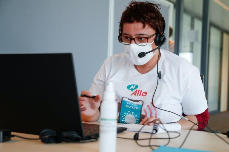 Contact tracing for infectious diseases has been traditionally done by people in call centers such as this one in Brussels in a May 20, 2020 photo (AFP Photo/Aris Oikonomou)