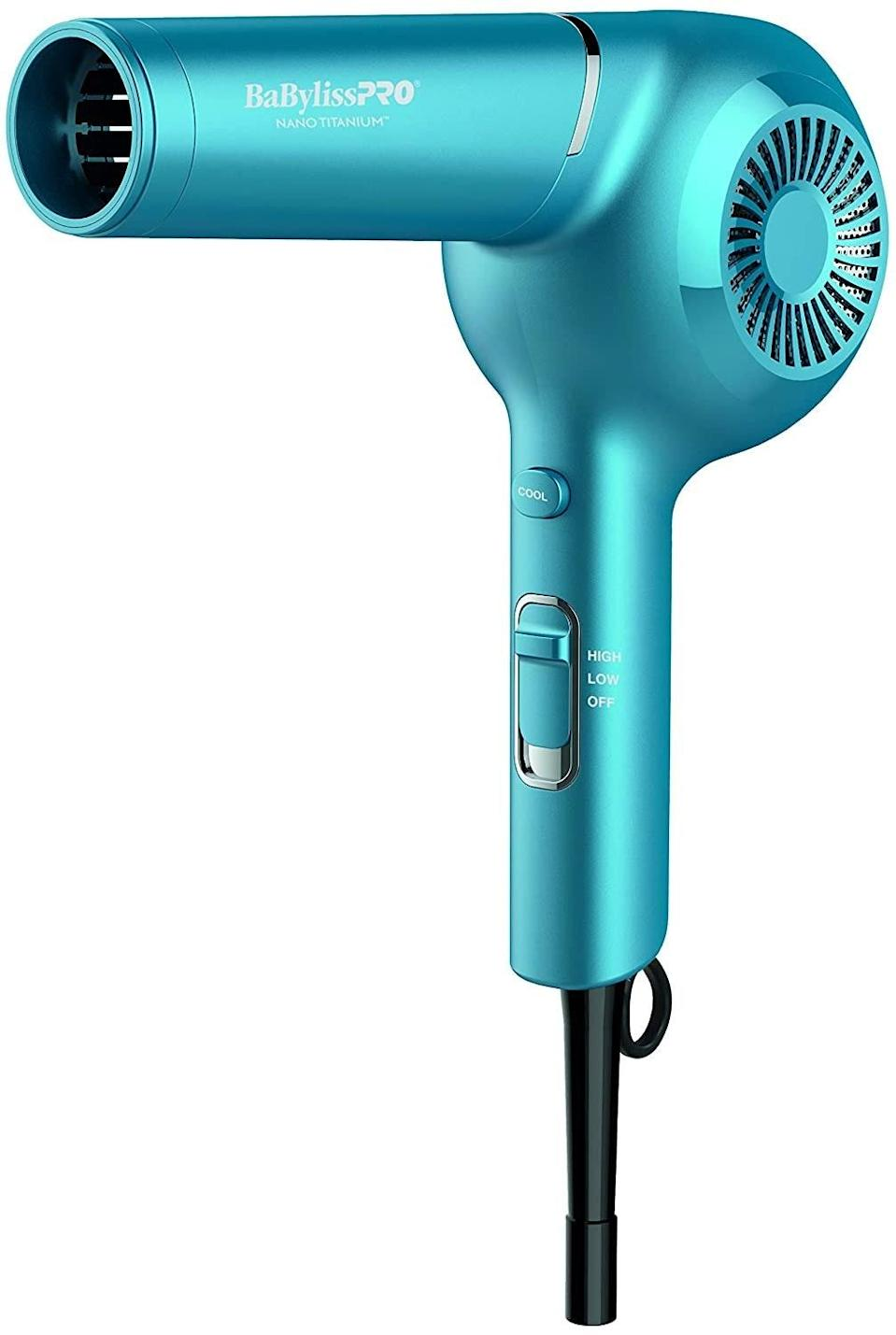 """Kayganich regularly recommends the BabylissPro Nano Titanium Classic Pistol Grip Dryer to her clients. """"I actually use this one at home,"""" she says. """"I have had mine for about eight years now, and it shows no sign of slowing down."""" She recommends diffusing on low heat and low speed, and this dryer makes it so easy with three settings of low, medium, and high. """"This is important for people with curly hair because we need to be able to minimize damage and frizz when we want to have a longer-lasting style and healthy hair,"""" Kayganich says."""