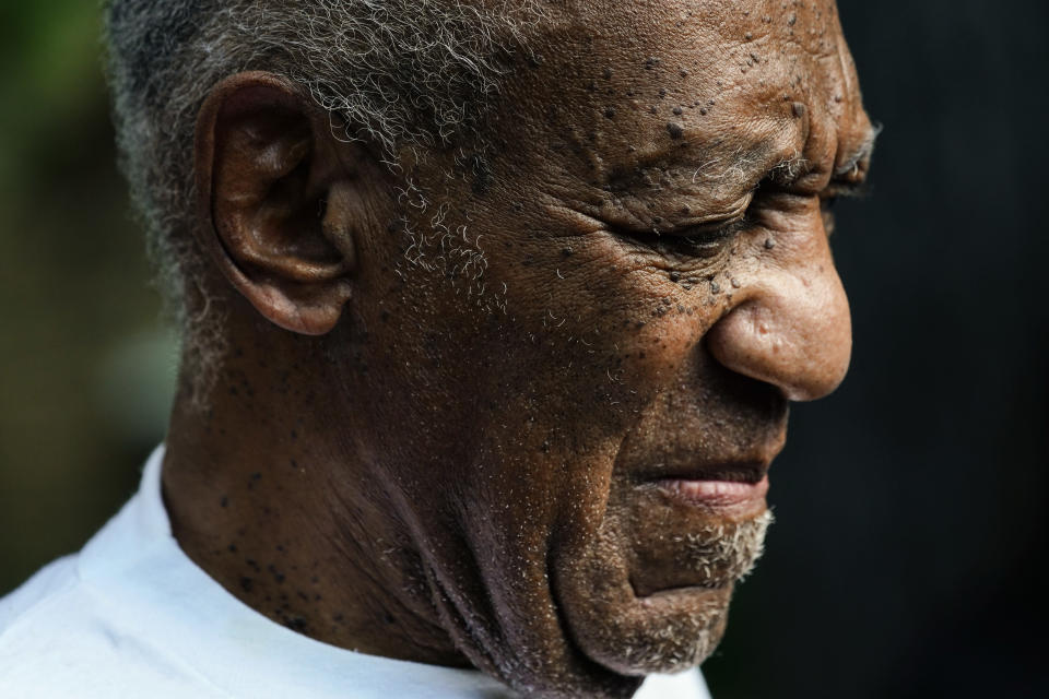 Bill Cosby listens to members of his team speak during a news conference outside his home in Elkins Park, Pa., Wednesday, June 30, 2021, after being released from prison. Pennsylvania's highest court has overturned comedian Cosby's sex assault conviction. The court said Wednesday, that they found an agreement with a previous prosecutor prevented him from being charged in the case. The 83-year-old Cosby had served more than two years at the state prison near Philadelphia and was released. (AP Photo/Matt Rourke)