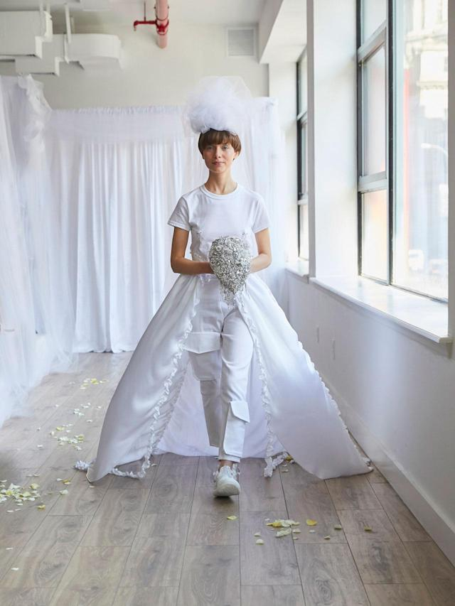 <p>Model mimics a bride in a bridal pantsuit look at the Collina Strada Fall/Winter 2018 show. (Photo: Jonathan Hokklo) </p>