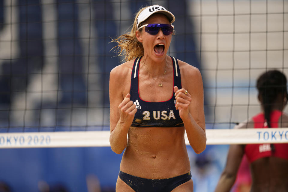 Alix Klineman, of the United States, reacts to a play during a women's beach volleyball match against Cuba at the 2020 Summer Olympics, Monday, Aug. 2, 2021, in Tokyo, Japan. (AP Photo/Petros Giannakouris)