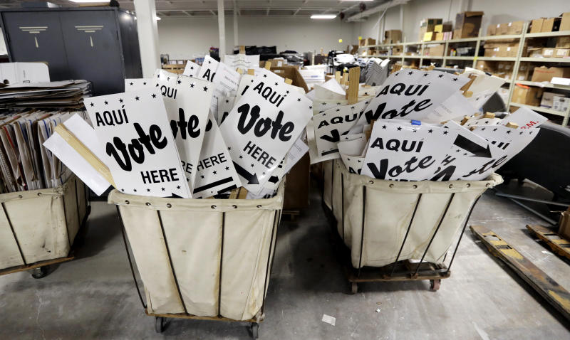 CORRECTS TO BEXAR COUNTY, NOT BEAR - Bins of signs are seen in a storage are at the Bexar County Election offices, Tuesday, Feb. 13, 2018, in San Antonio. The first primaries of the 2018 elections are less than a month away, but efforts to safeguard the vote against expected Russian interference are lagging. Texas will hold the first primary of 2018 on March 6. (AP Photo/Eric Gay)