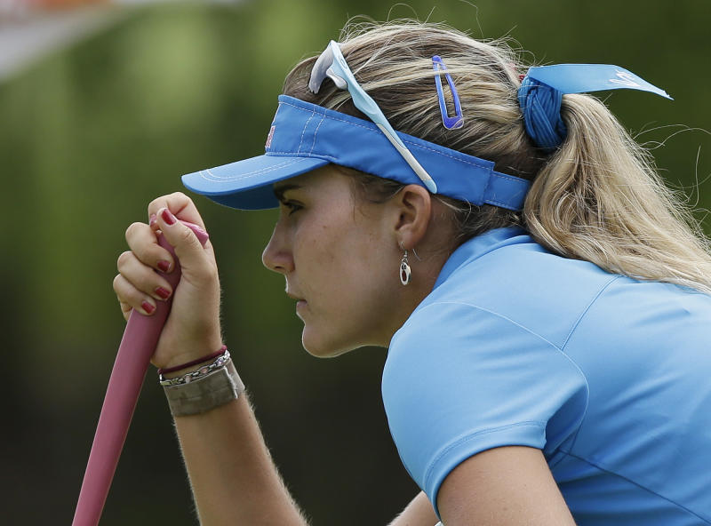 Lexi Thompson of the US lines up a putt during her final round at the Malaysian LGPA event in Kuala Lumpur, Sunday, Oct. 13, 2013. (AP Photo/Mark Baker)