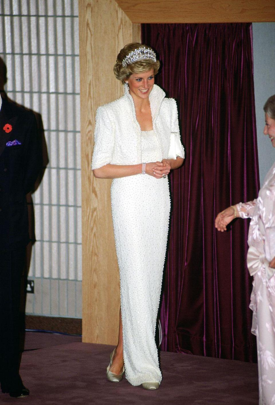 """<p>During a royal visit to Hong Kong, the Princess wore a white silk dress with pearl and sequined <a href=""""https://collections.vam.ac.uk/item/O130882/the-elvis-dress-state-evening-ensemble-walker-catherine/"""" rel=""""nofollow noopener"""" target=""""_blank"""" data-ylk=""""slk:detailing by Catherine Walker"""" class=""""link rapid-noclick-resp"""">detailing by Catherine Walker</a> that is now called """"The Elvis Dress"""" by many. </p>"""