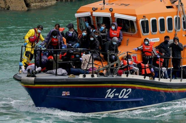 A group of people thought to be migrants are brought in to Dover, Kent, onboard a lifeboat