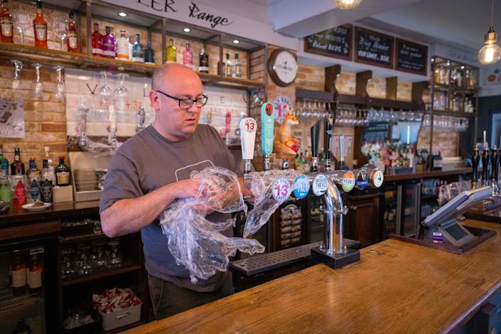 Carl Elliott, manager of The Village Pub, at his pub in Walthamstow, northeast London as he prepares for partial re-opening on 12 April. Photo: Tolga Akmen/AFP via Getty Images