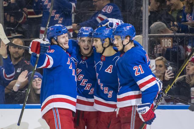 New York Rangers defenseman Brady Skjei (76) celebrates his goal with defenseman Jacob Trouba (8), center Chris Kreider, second from right, and center Brett Howden (21) during the second period of an NHL hockey game against the Florida Panthers, Sunday, Nov. 10, 2019, in New York. (AP Photo/Corey Sipkin)