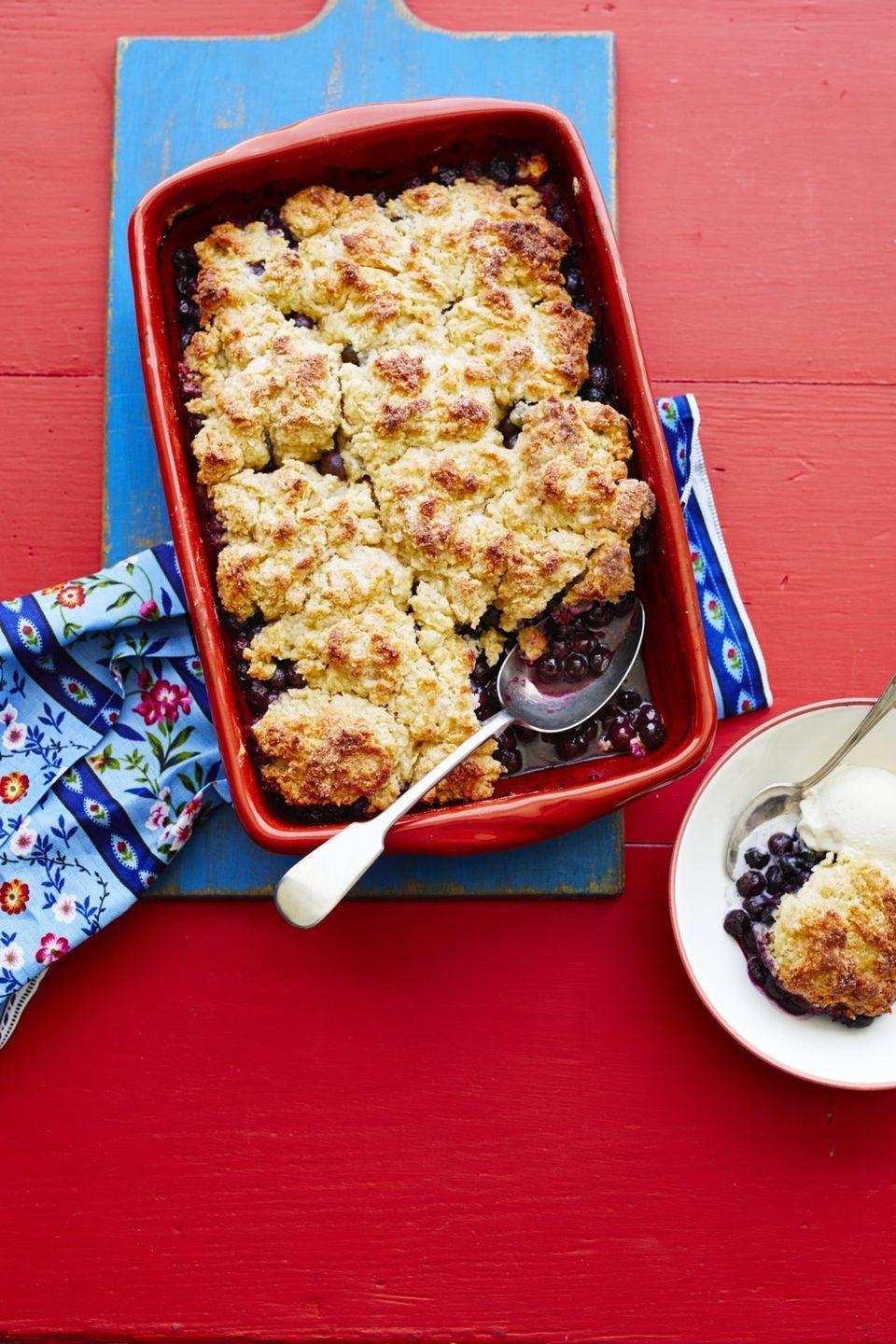 """<p>This crumbly blueberry cobbler is a crowd-pleaser. Don't forget the whipped cream!</p><p><strong><a href=""""https://thepioneerwoman.com/food-cooking/recipes/a32098873/blueberry-cobbler-recipe/"""" rel=""""nofollow noopener"""" target=""""_blank"""" data-ylk=""""slk:Get the recipe."""" class=""""link rapid-noclick-resp"""">Get the recipe.</a></strong></p><p><a class=""""link rapid-noclick-resp"""" href=""""https://go.redirectingat.com?id=74968X1596630&url=https%3A%2F%2Fwww.walmart.com%2Fip%2FThe-Pioneer-Woman-Spring-Bouquet-2-Piece-Baker-Set%2F595449072&sref=https%3A%2F%2Fwww.thepioneerwoman.com%2Ffood-cooking%2Fmeals-menus%2Fg32109085%2Ffourth-of-july-desserts%2F"""" rel=""""nofollow noopener"""" target=""""_blank"""" data-ylk=""""slk:SHOP BAKING DISHES"""">SHOP BAKING DISHES</a></p>"""