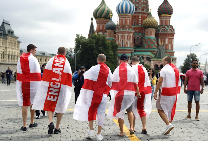 Happy and glorious: England fans show off their colours in Moscow's Red Square hours before kickoff. (PA)