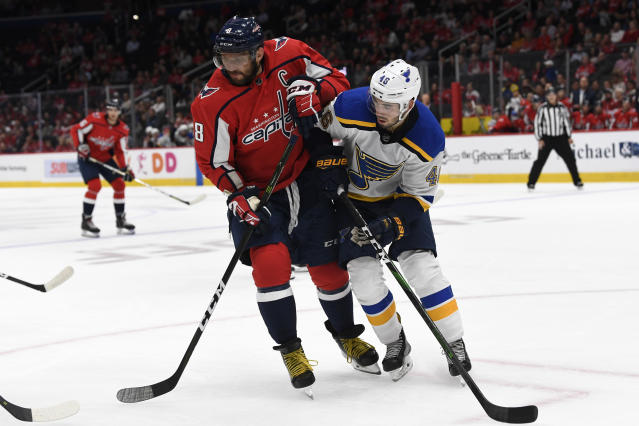 Washington Capitals left wing Alex Ovechkin (8), of Russia, battles with St. Louis Blues defenseman Jake Walman (46) during the second period of an NHL preseason hockey game in Washington, Wednesday, Sept. 18, 2019. (AP Photo/Susan Walsh)