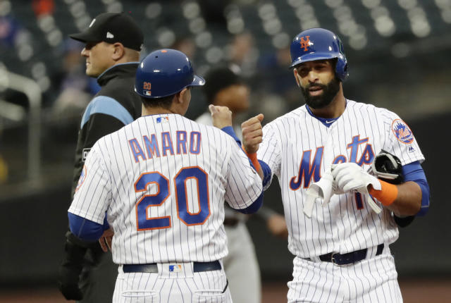 New York Mets' Jose Bautista, right, celebrates with first base coach Ruben Amaro Jr (20) after hitting a double during the second inning of a baseball game against the Miami Marlins Tuesday, May 22, 2018, in New York. (AP Photo/Frank Franklin II)