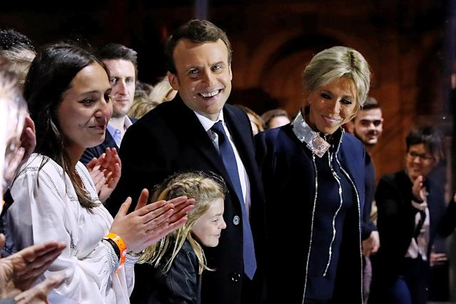 <p>French president-elect Emmanuel Macron celebrates on stage with wife Brigitte Trogneux during his victory rally near the Louvre museum in Paris, May 7, 2017. (Thomas Samson/Pool/Reuters) </p>