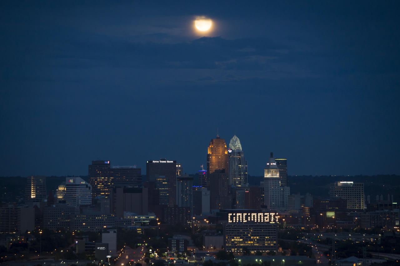 CINCINNATI, OH - AUGUST 31:  In this handout provided by the National Aeronautics and Space Administration, a second full moon of the month, known as a Blue Moon, shines over the city August 31, 2012 in Cincinnati, Ohio. The family of Apollo 11 astronaut Neil Armstrong held a memorial service celebrating his life earlier in the day in Cincinnati. Armstrong, the first man to walk on the moon during the 1969 Apollo 11 mission, died August 25. He was 82. (Photo by Bill Ingalls/NASA via Getty Images)