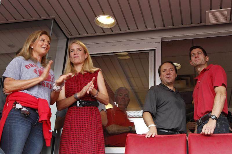 Republican vice presidential candidate, Rep. Paul Ryan, R-Wis., right, and his wife Janna second from right watch the pre-game activities with Rep. Pat Tiberi, R-Ohio, second from right, and his wife Denise, left, at The Ohio State University-Miami University of Ohio football game, Saturday, Sept. 1, 2012, at Ohio Stadium in Columbus, Ohio. (AP Photo/Mary Altaffer)