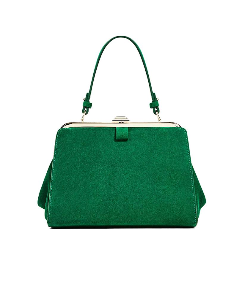 "<p>Mini Split Suede City Bag, $70, <a rel=""nofollow"" href=""http://www.zara.com/us/en/woman/bags/hand-bags/mini-split-suede-city-bag-c358020p4065064.html"">Zara.com</a> </p>"