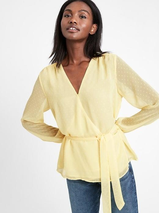 <p>The textured dots and sheer sleeves give this <span>Banana Republic Chiffon Wrap Top</span> ($67, originally $85) a dressy look (but it can still be washed right in the machine, too).</p>
