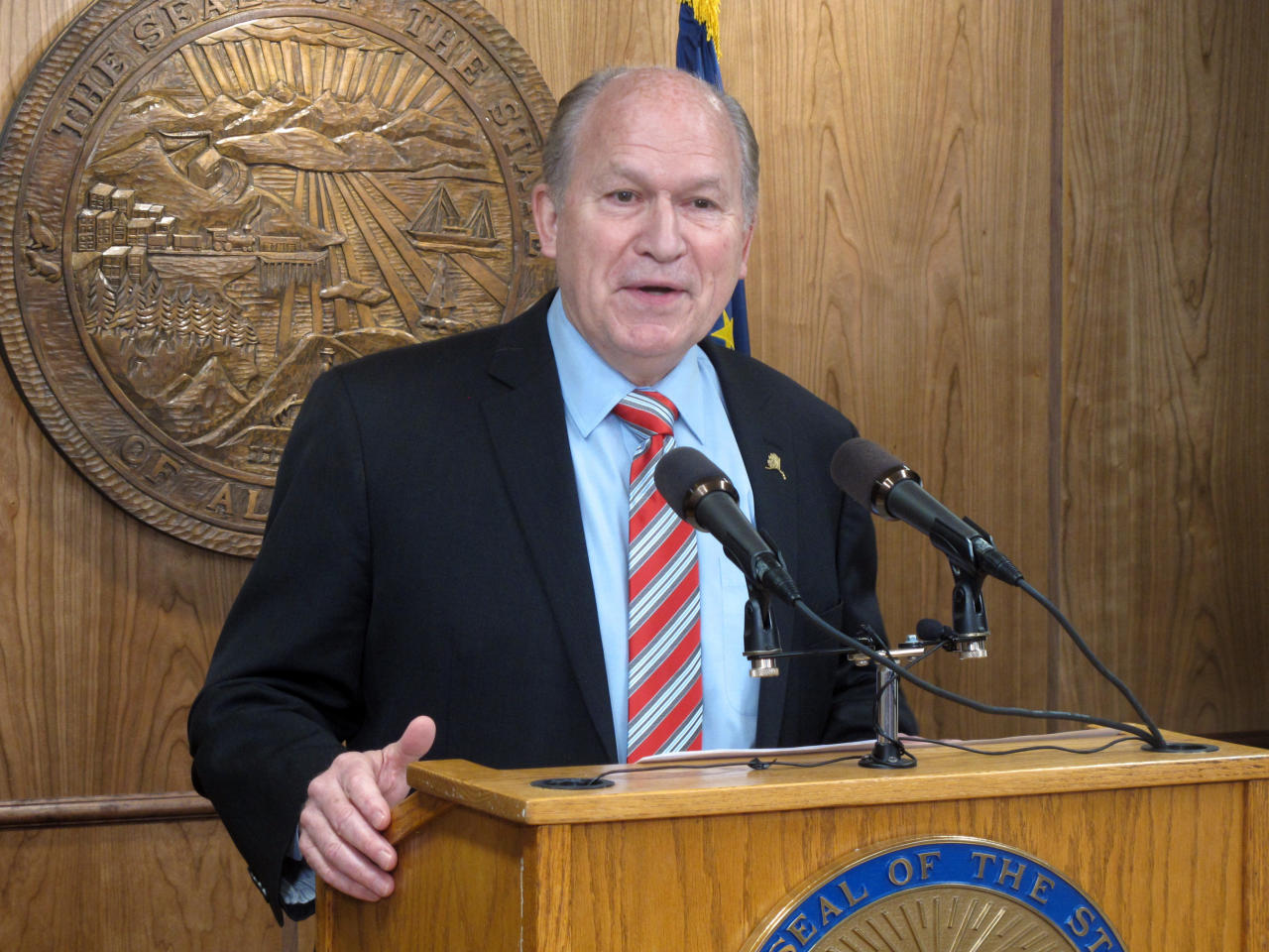 FILE - In this Tuesday, April 18, 2017, file photo, Alaska Gov. Bill Walker addresses reporters during a news conference in Juneau, Alaska. Governors in states that expanded Medicaid are wary of a bill revealed Thursday, June 22, by Republican leaders in the U.S. Senate. The expansion of the state-federal program has allowed 11 million lower-income Americans to gain health coverage. Walker, a Republican-turned-independent, said in a statement Thursday that he is still reviewing the Senate plan, but had some worries about how it might affect his vast and sparsely populated state, where health care costs are high. (AP Photo/Becky Bohrer, File)