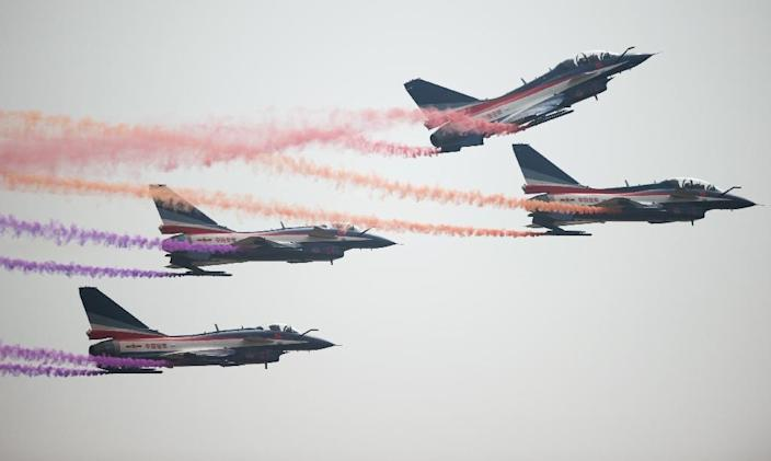 J-10 fighter jets of the Bayi Aerobatic Team of Peoples Liberation Army Air Force perform at the Airshow China 2014 in Zhuhai, south China's Guangdong province on November 12, 2014 (AFP Photo/Johannes Eisele)