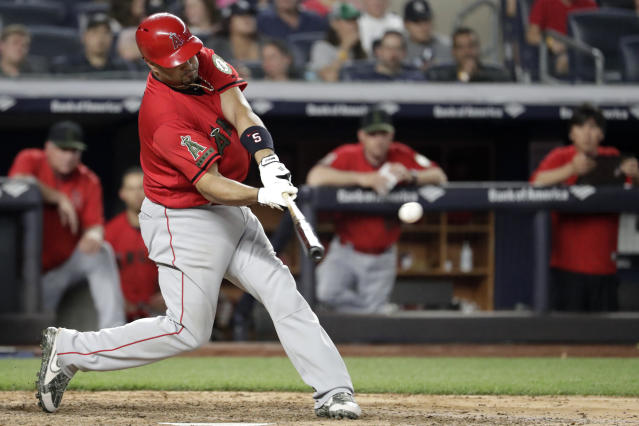 Los Angeles Angels' Albert Pujols hits a single off New York Yankees relief pitcher Tommy Kahnle during the sixth inning of a baseball game Saturday, May 26, 2018, in New York. (AP Photo/Julio Cortez)