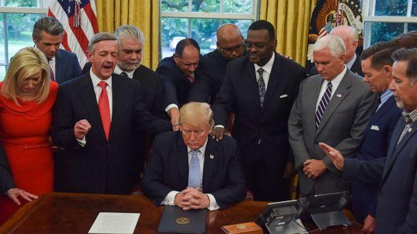 PHOTO: Donald J. Trump, backed by faith leaders, declared a National Day of Prayer for victims of Hurrican Harvey in the Oval Office of the White House on Sept. 1, 2017, in Washington, DC. (Jahi Chikwendiu/The Washington Post via Getty Images, FILE)
