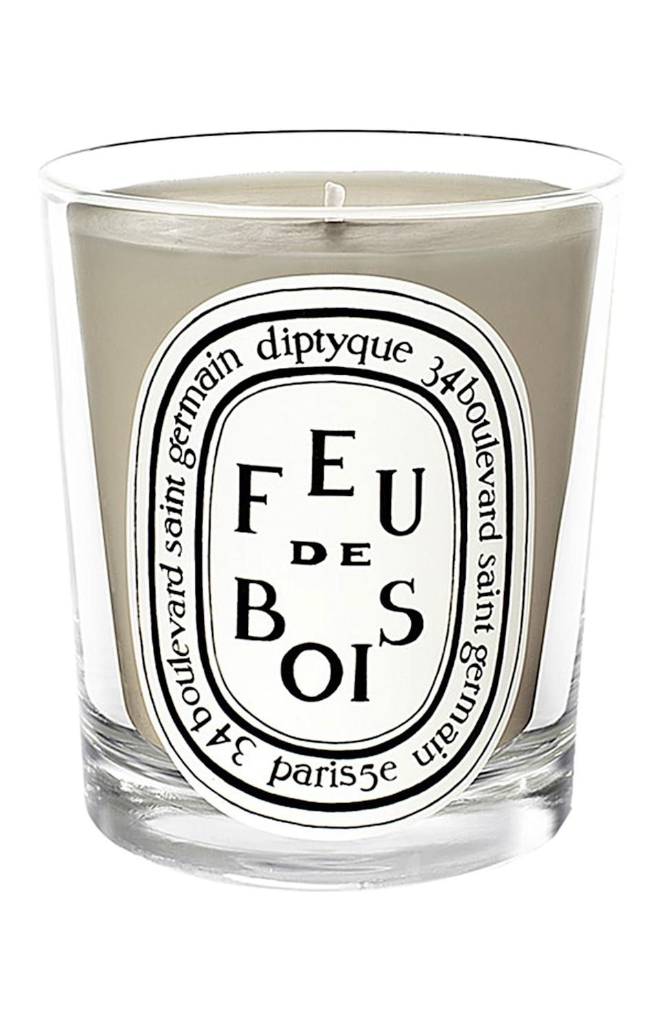 """<h3>Diptyque Feu De Bois Candle</h3><br>According to this Nordstrom review, this popular scent from Diptique can warm up the grayest of London days; """"Smells like a crackling fire and is my favorite candle to have burning during autumn and winter. Makes even my London home feel as though there's a crackling, cozy fire going and makes snuggling up on the sofa when it's too grim outside that much more of a pleasure. It's also one of the longer lasting candle scents from Diptyque. I always ask for this for Christmas!""""<br><br><strong>Diptyque</strong> Feu de Bois Candle 2.4oz, $, available at <a href=""""https://go.skimresources.com/?id=30283X879131&url=https%3A%2F%2Fshop.nordstrom.com%2Fs%2Fdiptyque-feu-de-bois-wood-fire-scented-candle%2F3228001"""" rel=""""nofollow noopener"""" target=""""_blank"""" data-ylk=""""slk:Nordstrom"""" class=""""link rapid-noclick-resp"""">Nordstrom</a>"""