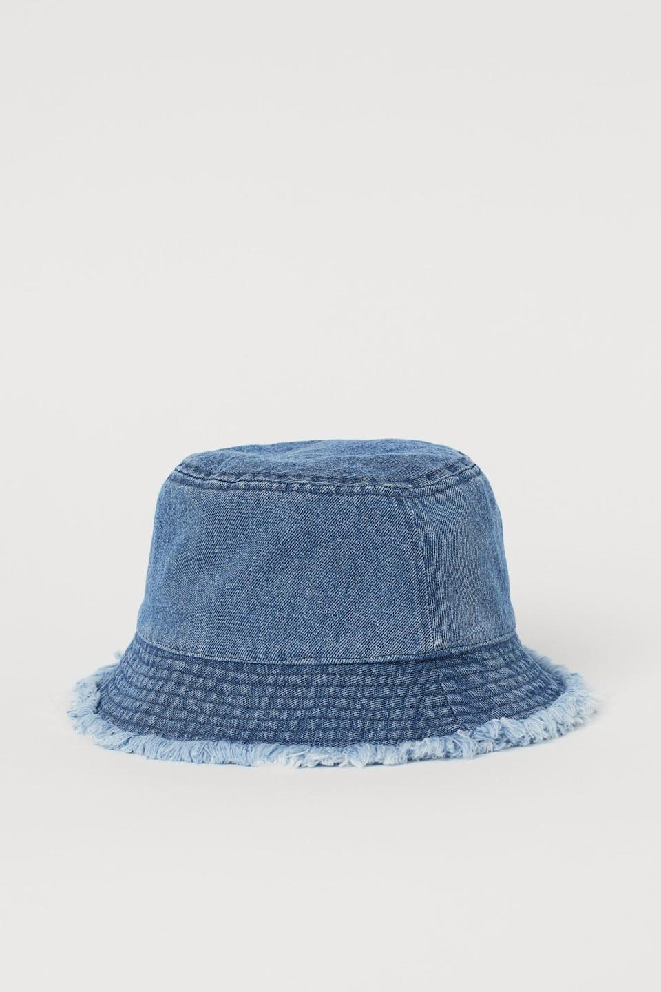 <p>Wear this <span>H&amp;M Frayed-edge Bucket Hat</span> ($10) with a full denim look for a statement monochrome outfit.</p>