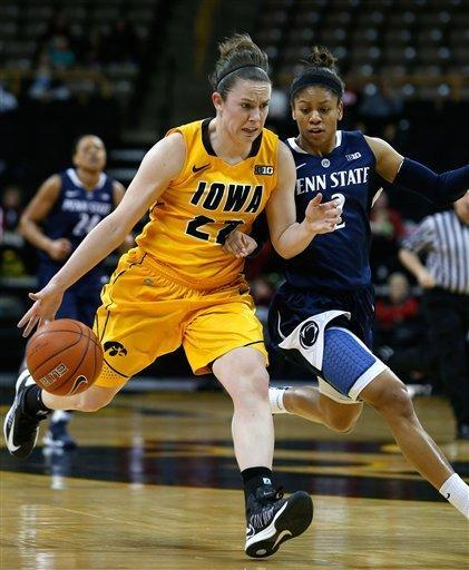 Iowa guard Samantha Logic (22) brings the ball downcourt under pressure from Penn State guard Dara Taylor (2) during the first half of an NCAA college basketball game on Thursday, Feb. 14, 2013, at Carver-Hawkeye Arena in Iowa City, Iowa. (AP Photo/The Gazette, Brian Ray)