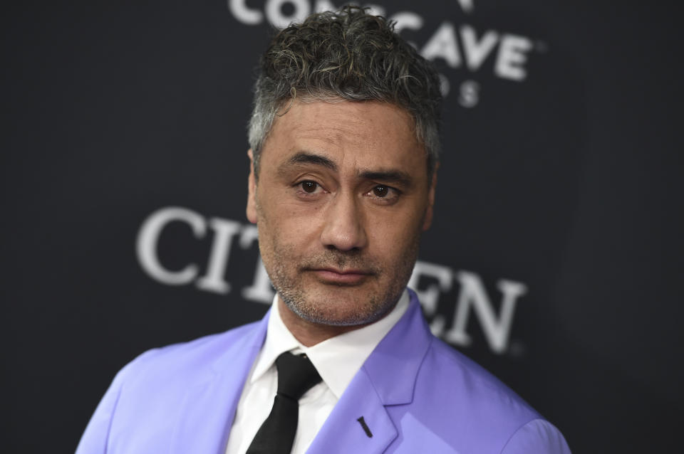"""Taika Waititi arrives at the premiere of """"Avengers: Endgame"""" at the Los Angeles Convention Center on Monday, April 22, 2019. (Photo by Jordan Strauss/Invision/AP)"""