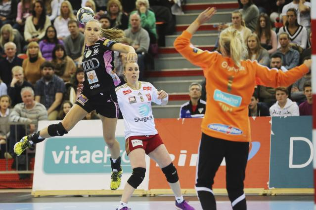 REFILE - SPELLING IN GYORI Gyori Audi ETO KC's Dorina Korsos (L) plays against Larvik during their women's handball Champions' League match in Arena Larvik February 28, 2015. REUTERS/Trond Reidar Teigen/NTB Scanpix (NORWAY - Tags: SPORT HANDBALL) THIS IMAGE HAS BEEN SUPPLIED BY A THIRD PARTY. IT IS DISTRIBUTED, EXACTLY AS RECEIVED BY REUTERS, AS A SERVICE TO CLIENTS. NORWAY OUT. NO COMMERCIAL OR EDITORIAL SALES IN NORWAY. NO COMMERCIAL SALES