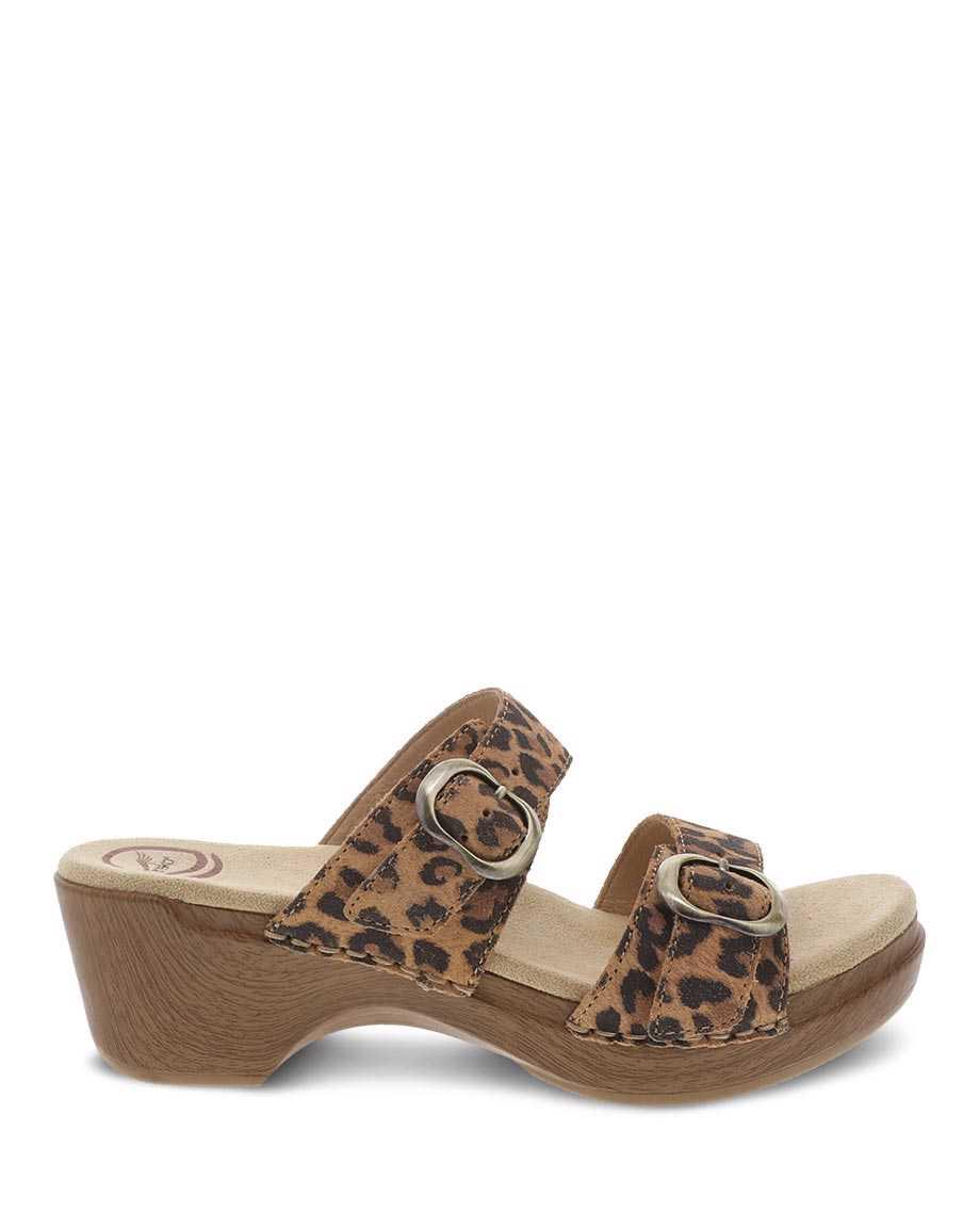 "<h3>Danko Sophie Sandal <br></h3><br>We don't need to remind you about our <a href=""https://www.refinery29.com/en-us/2020/08/9940976/dansko-professional-clogs-review"" rel=""nofollow noopener"" target=""_blank"" data-ylk=""slk:Dansko fangirl status"" class=""link rapid-noclick-resp"">Dansko fangirl status</a>. While we're thoroughly obsessed with the Professional clog, a commenter directed our attention to the equally cute and comfortable Sophie sandal. With a sublimely comfortable construction — one Dansko.com reviewer shed tears when she first tried the shoe — that includes an anatomically contoured sole, this jungle-inspired clog-slide hybrid is a great summer bet.<br><br><em>Shop <strong><a href=""https://www.dansko.com/womens-shoes-sandals"" rel=""nofollow noopener"" target=""_blank"" data-ylk=""slk:Dansko"" class=""link rapid-noclick-resp"">Dansko</a></strong></em><br><br><strong>Dansko</strong> Sophie Leopard Suede Slide, $, available at <a href=""https://go.skimresources.com/?id=30283X879131&url=https%3A%2F%2Fwww.dansko.com%2Fsophie-leopard-suede"" rel=""nofollow noopener"" target=""_blank"" data-ylk=""slk:Dansko"" class=""link rapid-noclick-resp"">Dansko</a>"