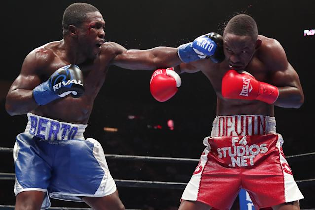 Andre Berto (L) lands a left hand against Devon Alexander during a PBC on Fox bout at the Nassau Veterans Memorial Coliseum on Aug. 4, 2018 in Uniondale, New York. (Getty Images)
