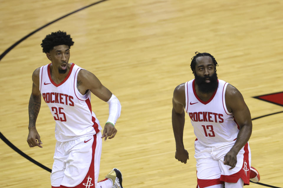 Houston Rockets' Christian Wood (35) and James Harden (13) look on during the third quarter of an NBA basketball game against the San Antonio Spurs in Houston, Thursday, Dec. 17, 2020. (Carmen Mandato/Pool Photo via AP)