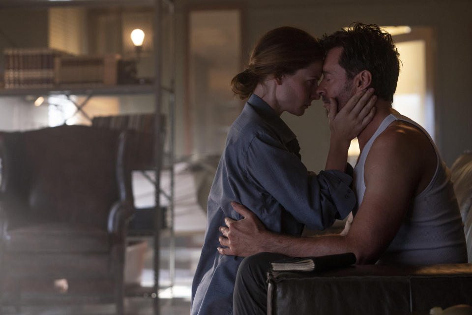 """This image released by Warner Bros. Pictures shows Rebecca Ferguson, left, and Hugh Jackman in a scene from """"Reminiscence."""" (Warner Bros. Pictures via AP)"""