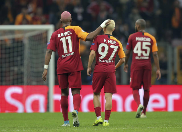 Galatasaray players leave the field at the end of the Champions League group A soccer match between Galatasaray and Real Madrid in Istanbul, Tuesday, Oct. 22, 2019. (AP Photo)